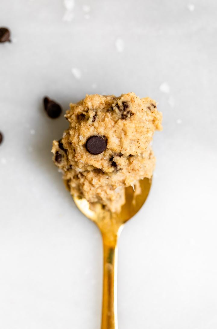Gold spoon with the chickpea cookie dough on top.