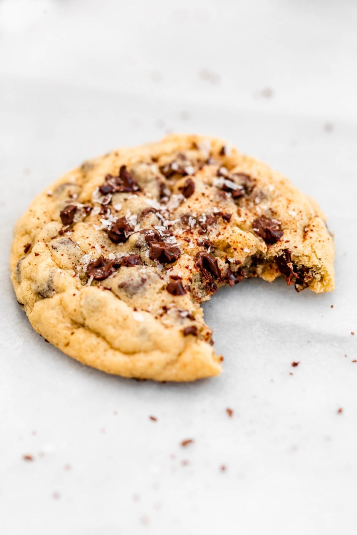 Gluten free cookie with sea salt on top on a marble background.