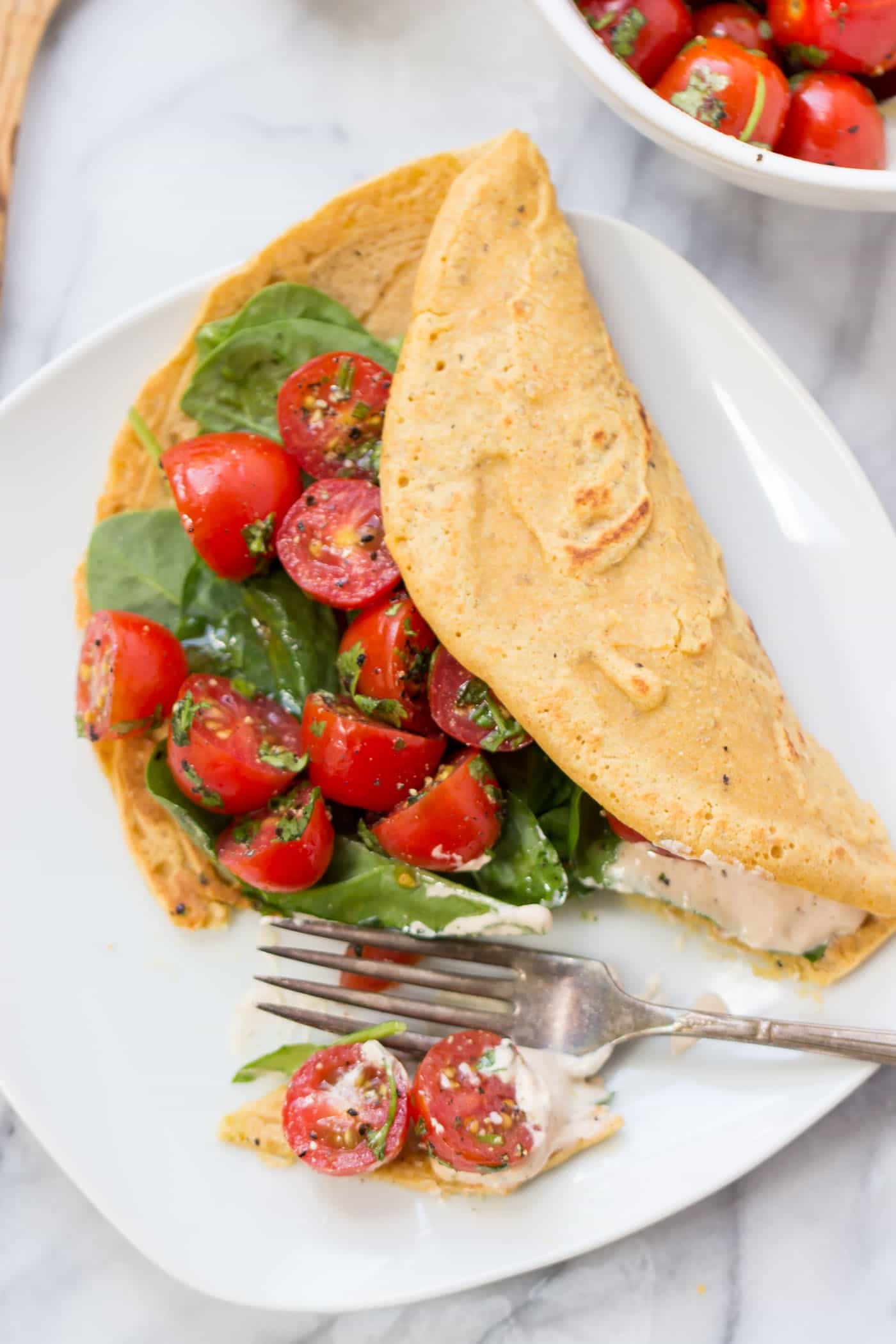 Savory chickpea pancake on a white plate for an easy vegan brunch.