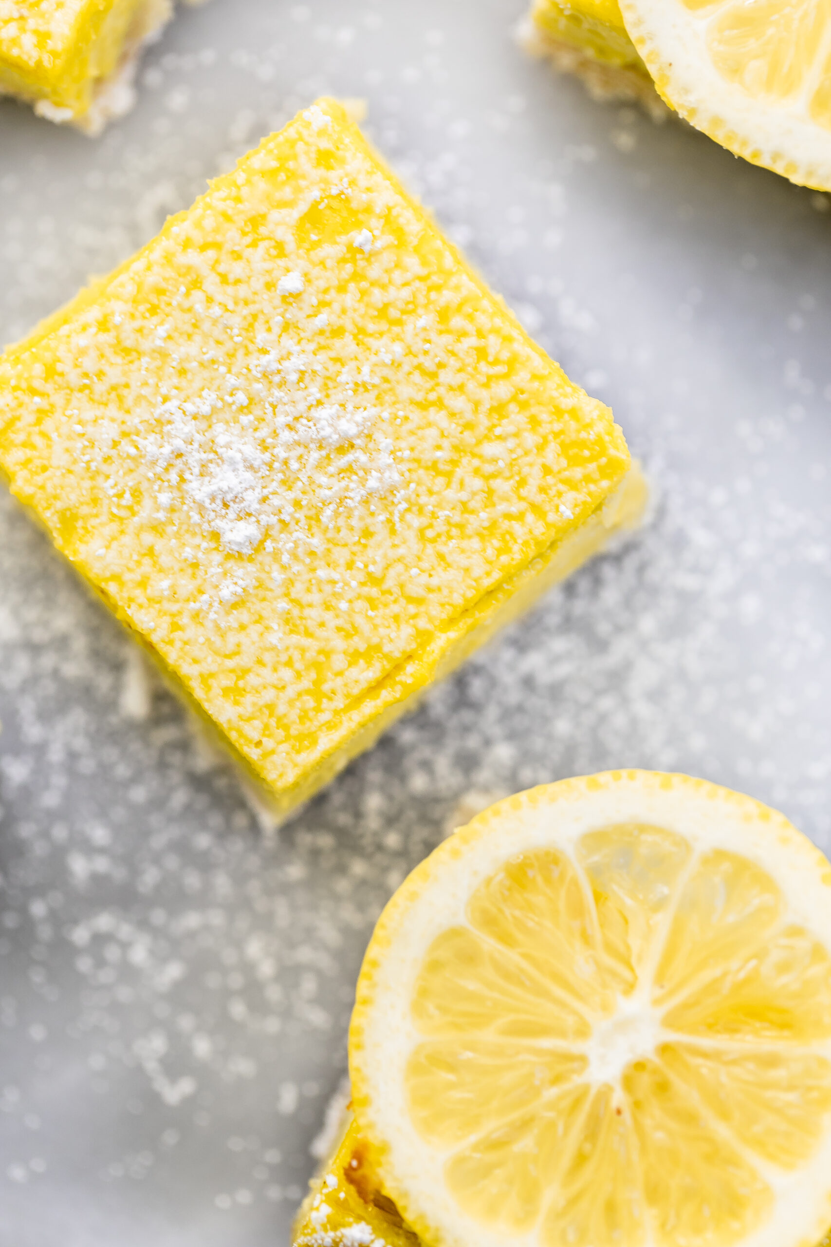 Overhead image of one bar with a lemon slice on top.