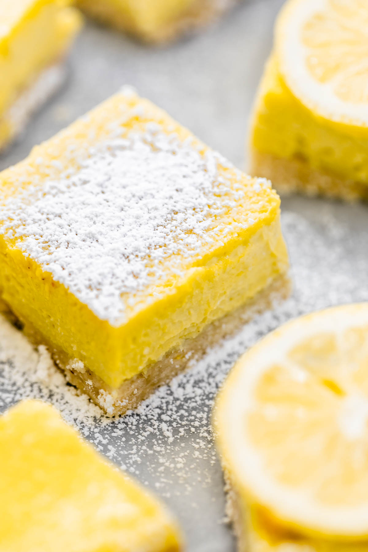 Up close image of the vegan lemon bars to show texture of the filling.