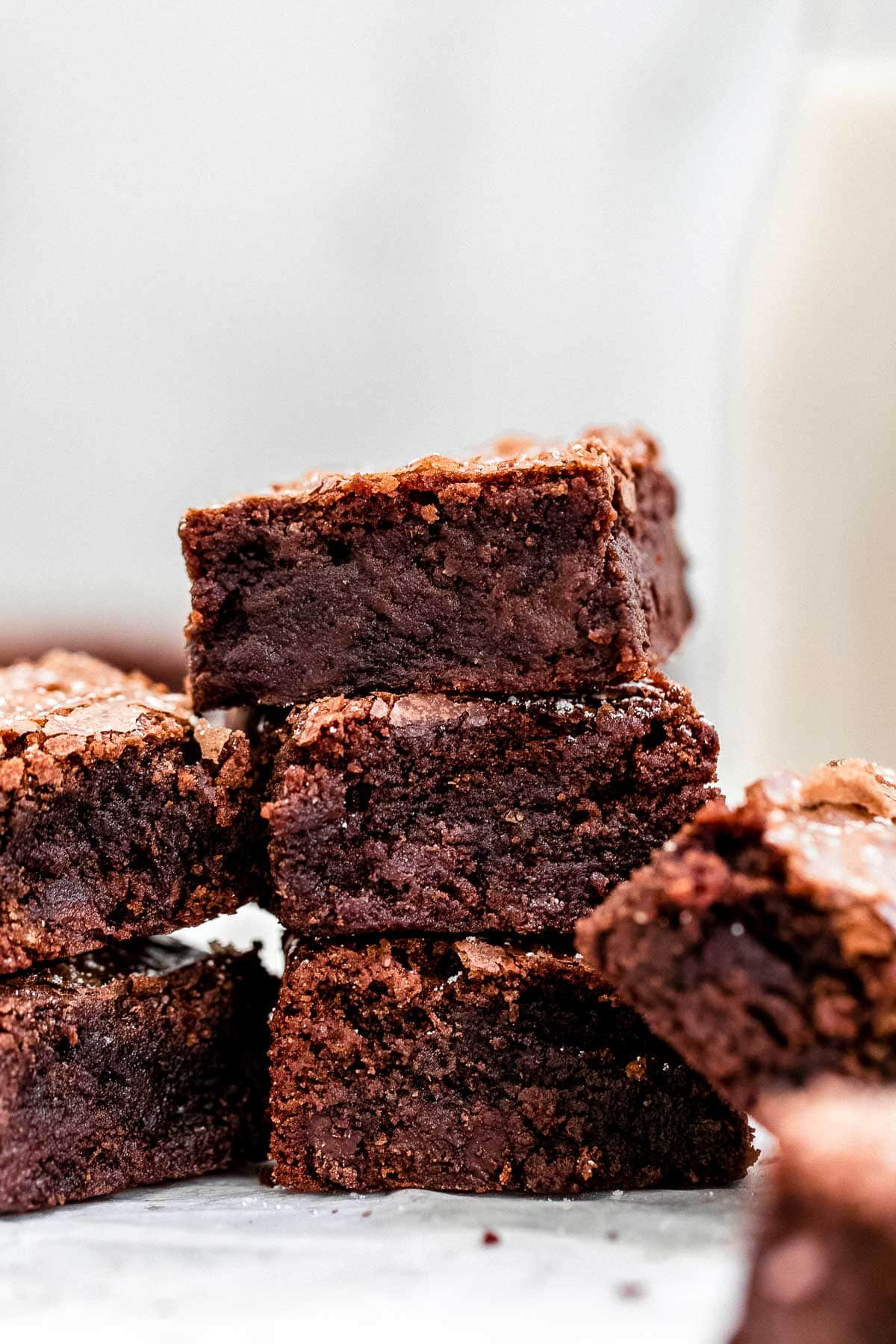 Three homemade fudgy brownies stacked on each other to show texture.