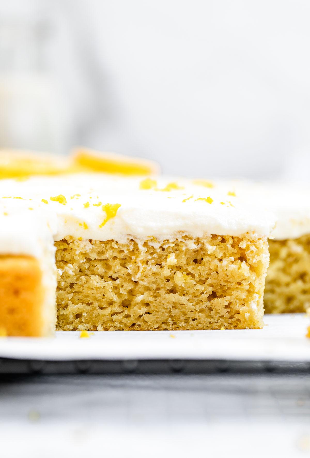 lemon sheet cake with lemon wedges on top