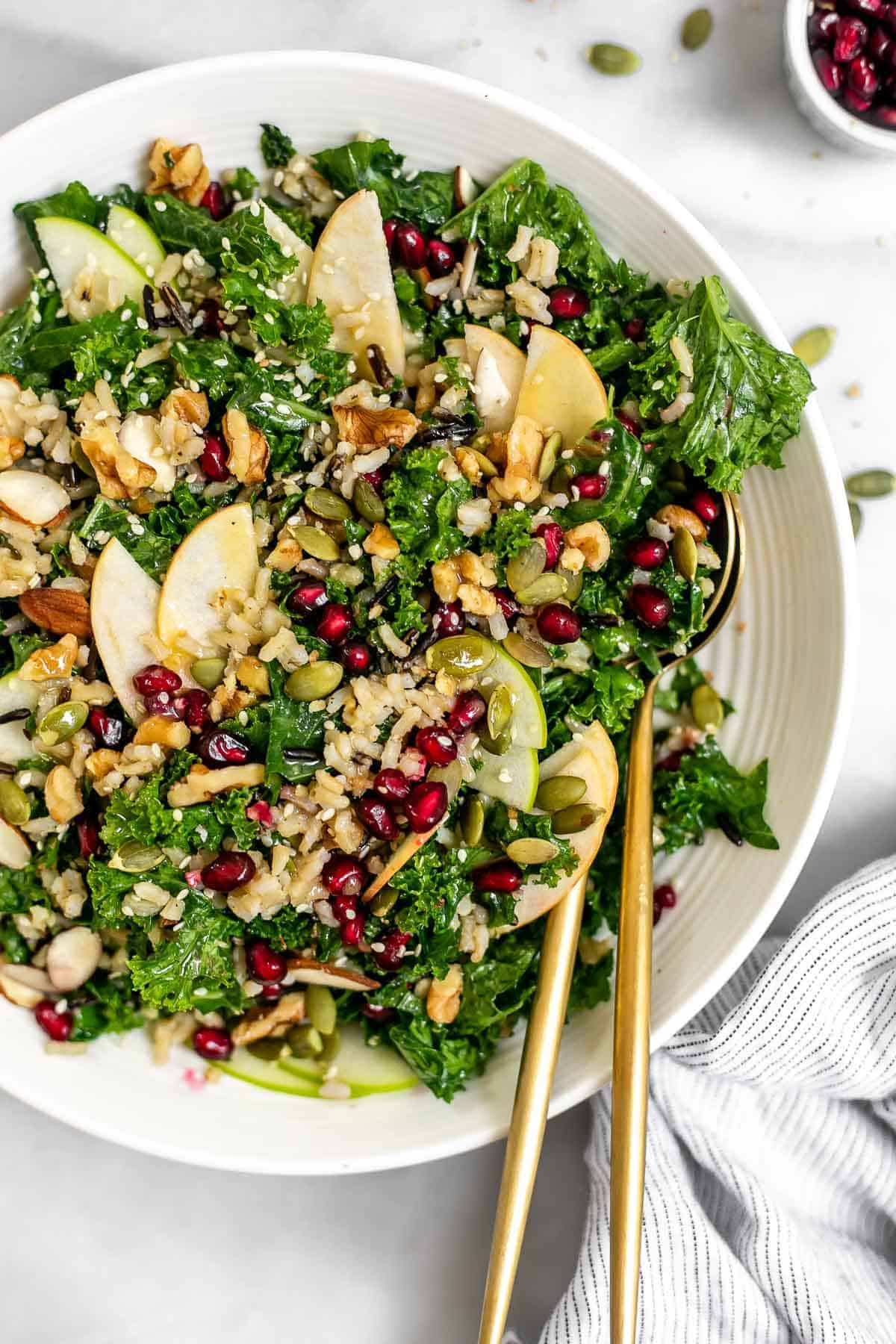 Up close image of the kale apple salad in a white bowl.