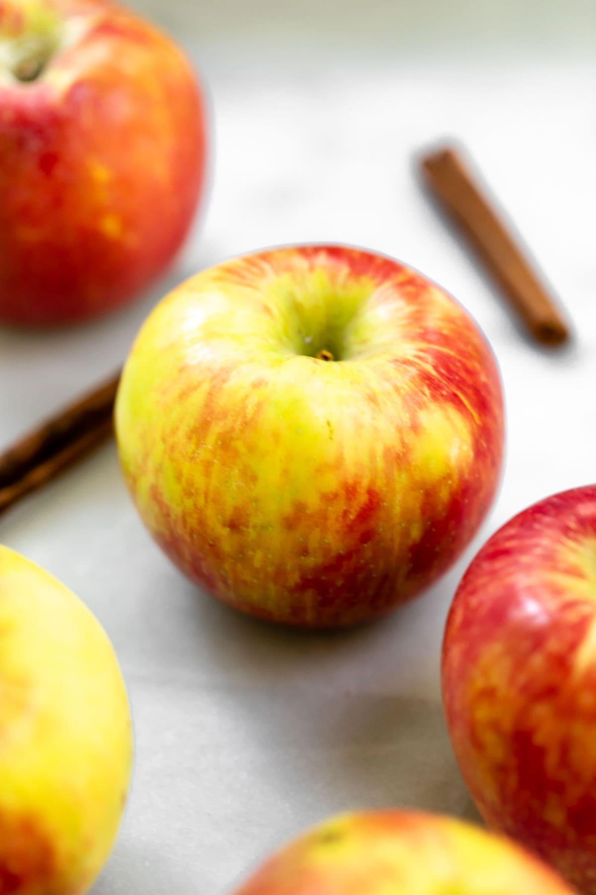 Apples and cinnamon sticks.