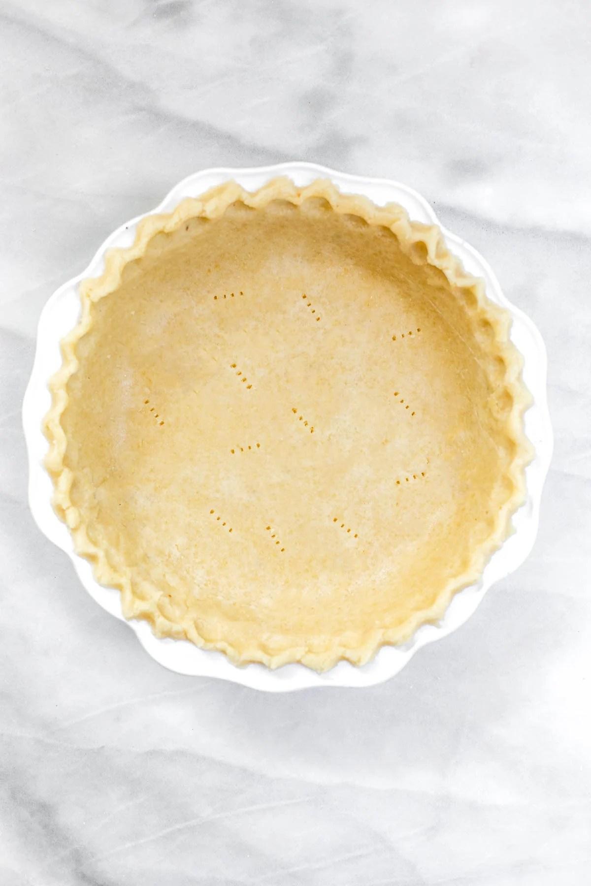 Final gluten free pie crust in a white plate.