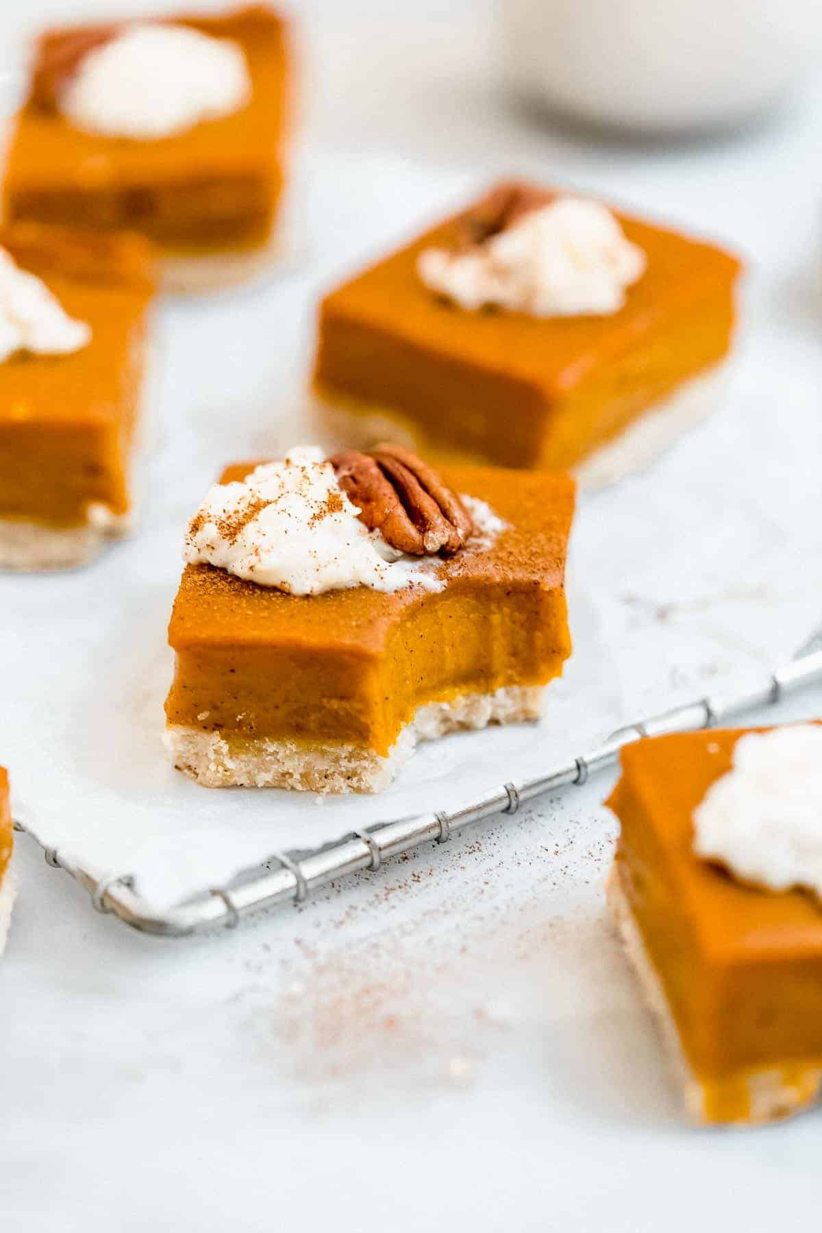 vegan sweet potato pie bars with milk in the back.