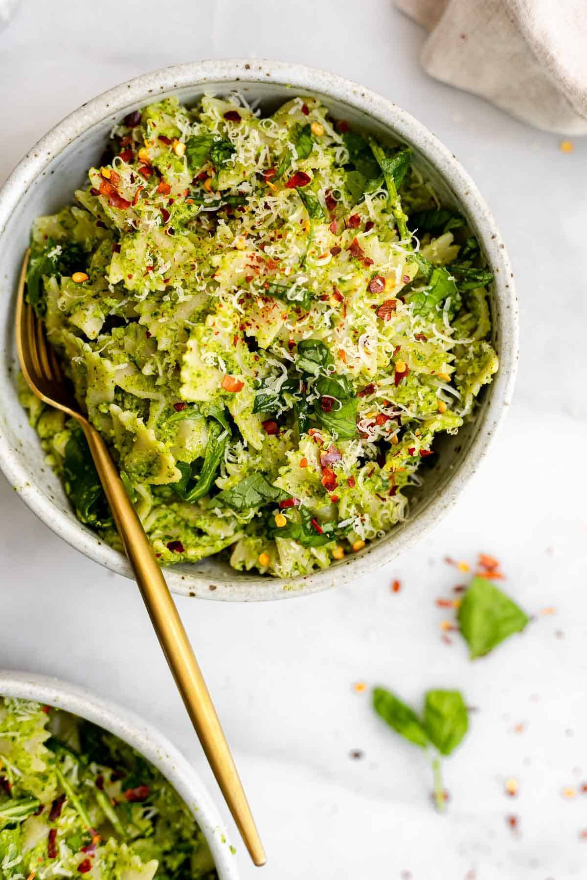 Up close view of the broccoli pesto with a gold fork.