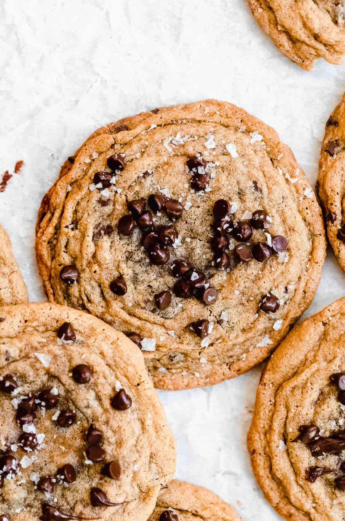 Cookies layered on each other with chocolate chips in the middle.