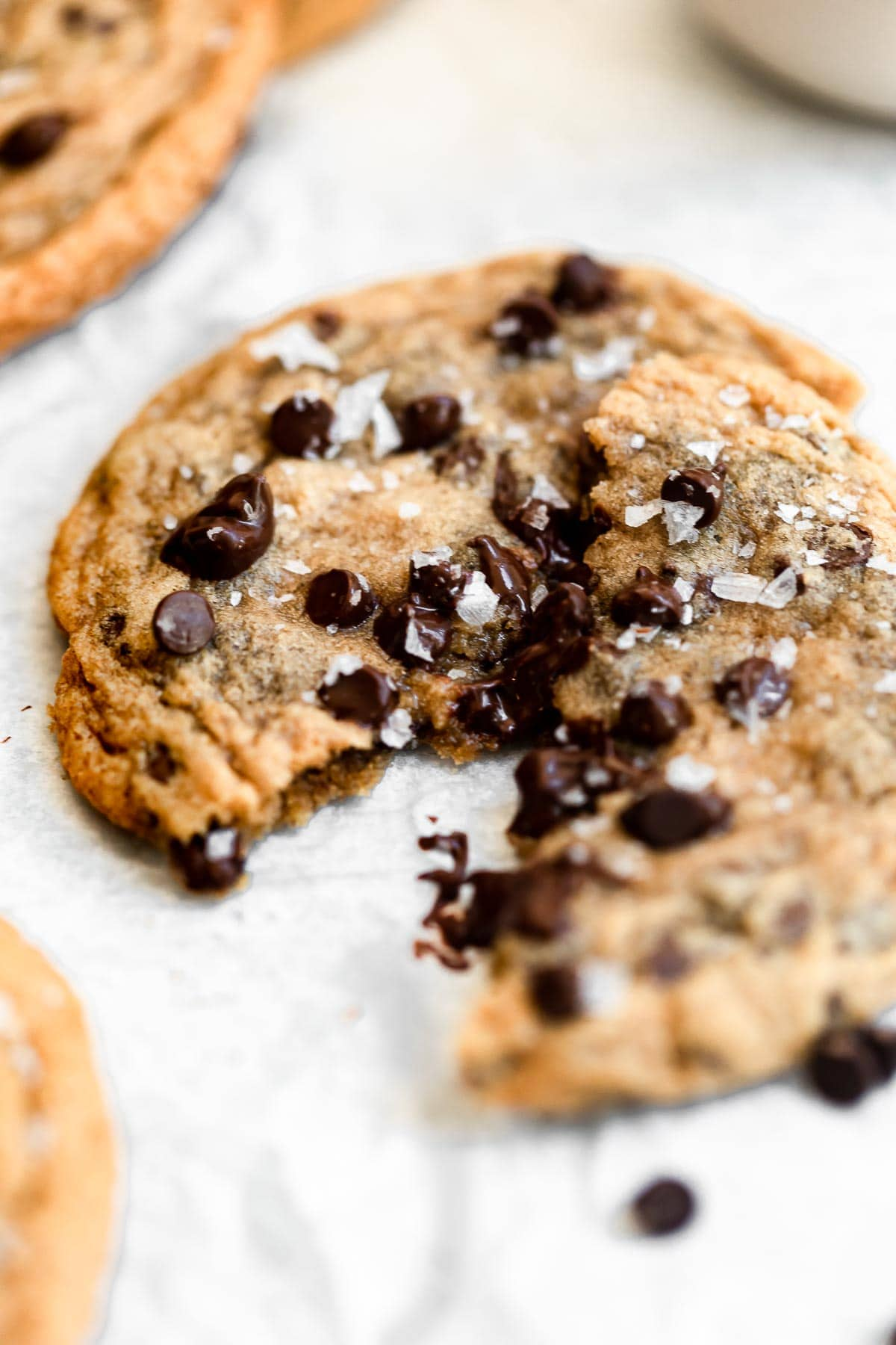 One cookie ripped in half with melted chocolate chips.