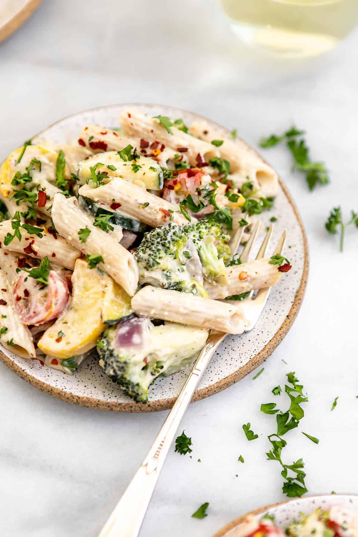 vegan pasta primavera on a plate with parsley