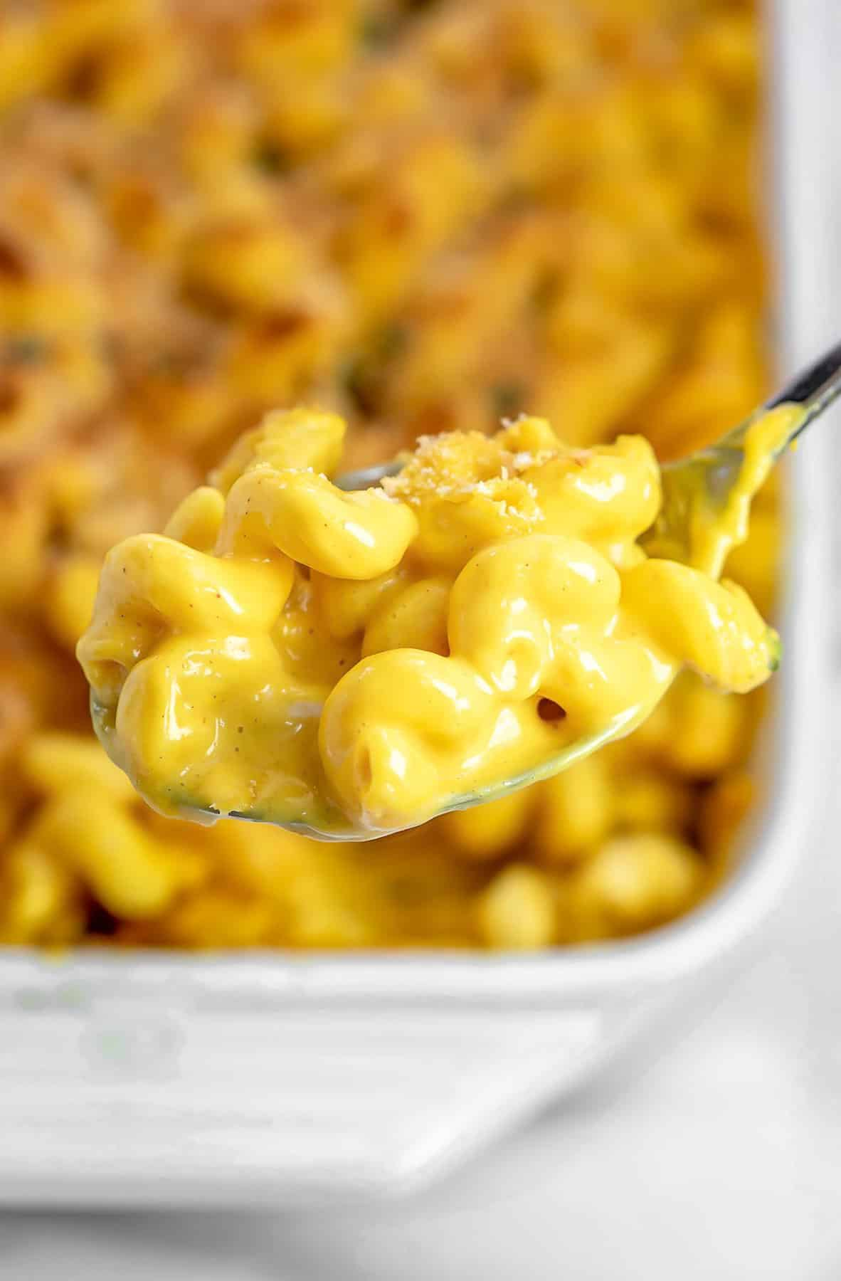 Spoon with the baked vegan mac and cheese