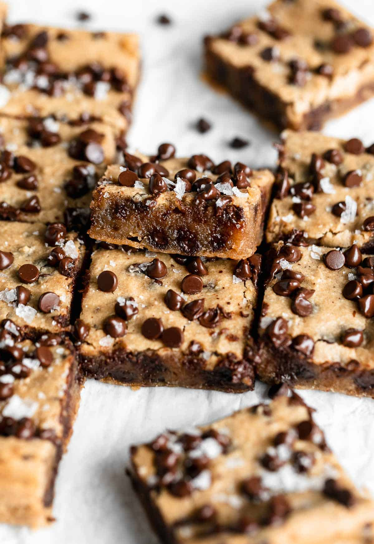 chickpea blondies on the side cut into squares to show gooey texture