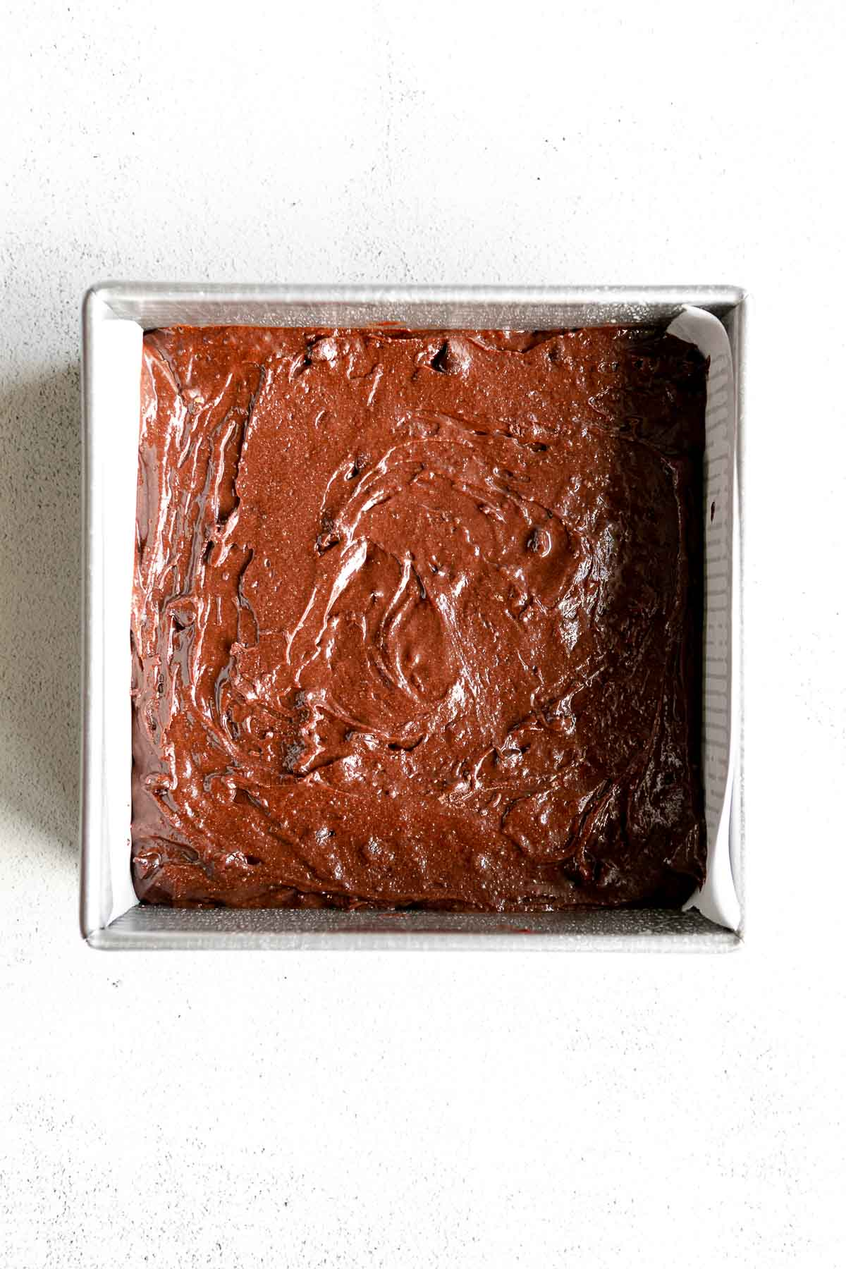 brownie batter in a pan before baking