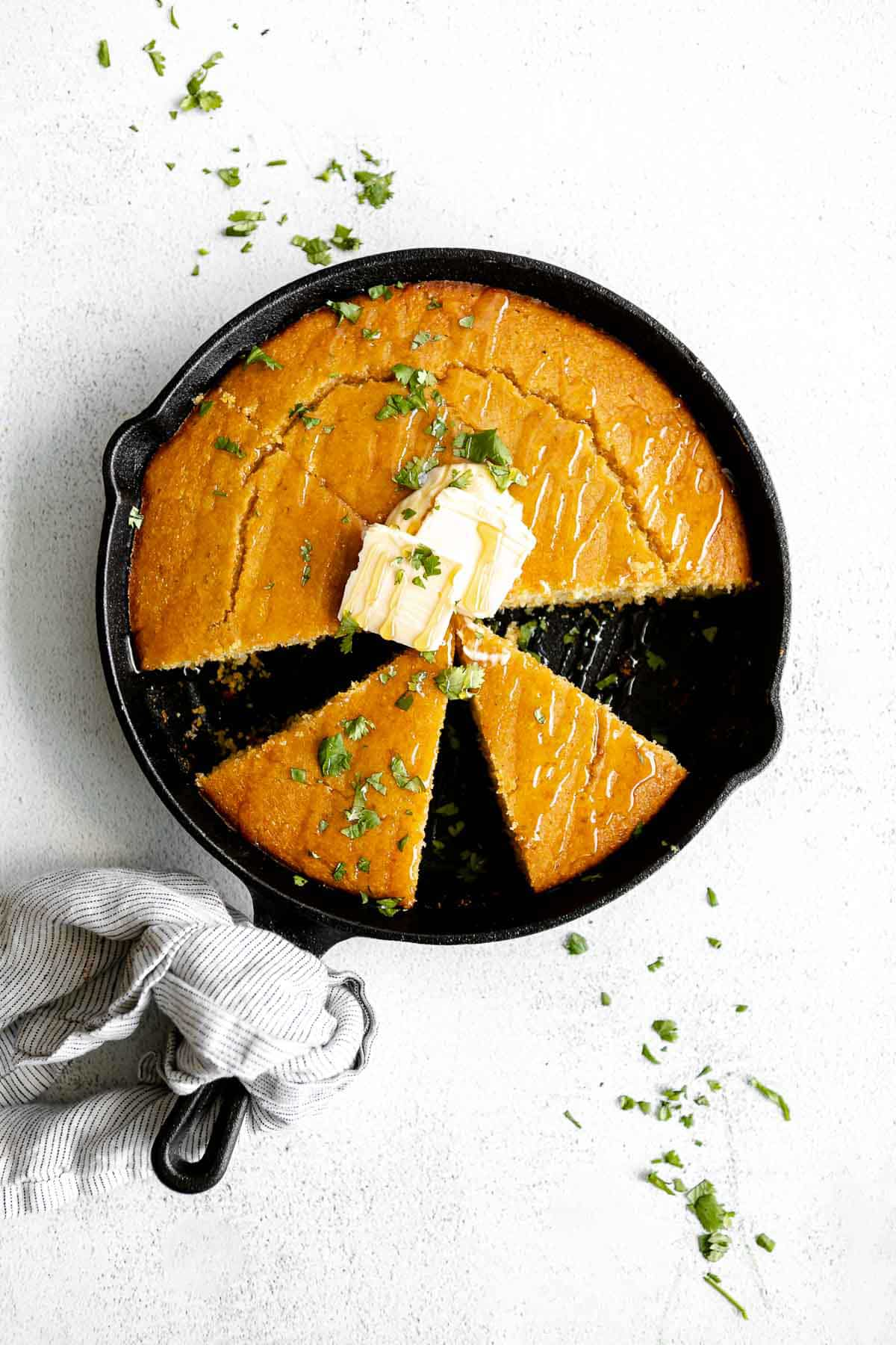 gluten free cornbread in a skillet with butter