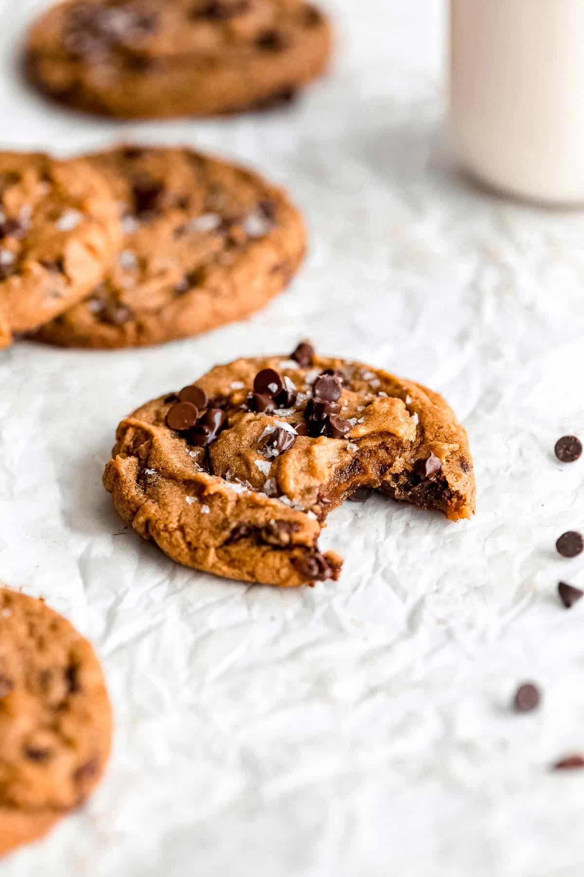 gluten free pumpkin cookies with chocolate chips on parchment paper