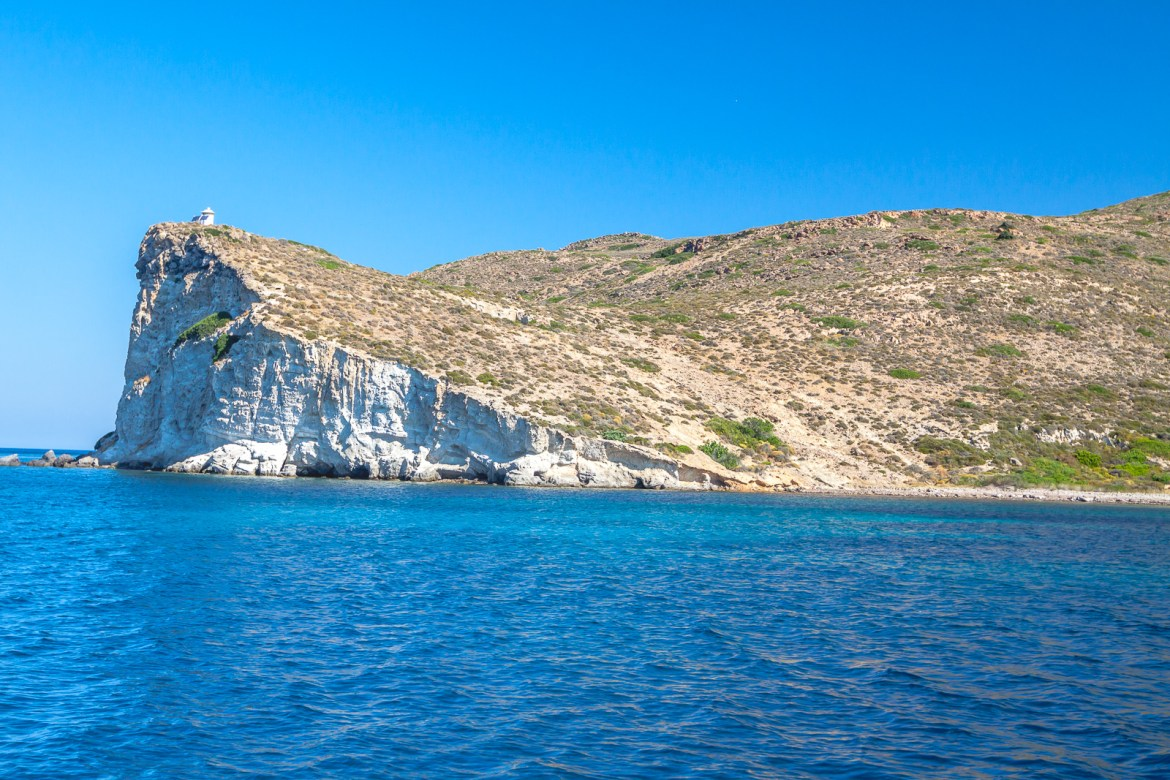 Milos, Greece is the picture-perfect island with unique formations against the bright blue waters of the Aegean Sea. Don't miss a boat tour to get great views of this stunning island! | www.eatworktravel.com - The luxury, adventure travel couple!