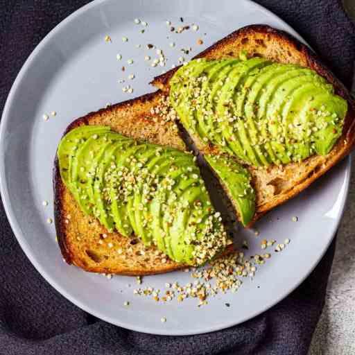 Avocado hemp toast on a white plate.