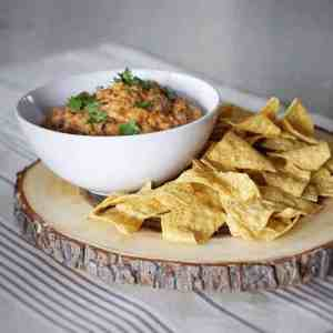 Healthy Creamy Chip Dip Recipe: A creamy savory chip dip that's sure to be a crowd pleaser. They'll never know that its healthy and has no cheese! Ground beef, hummus, salsa and spices.