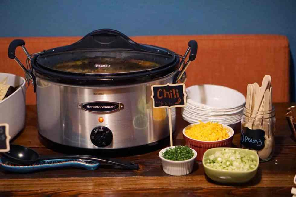 A chili bar is a great make ahead meal idea for a lumberjack themed party