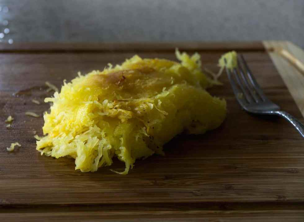 pulled spaghetti squash noodles on cutting board