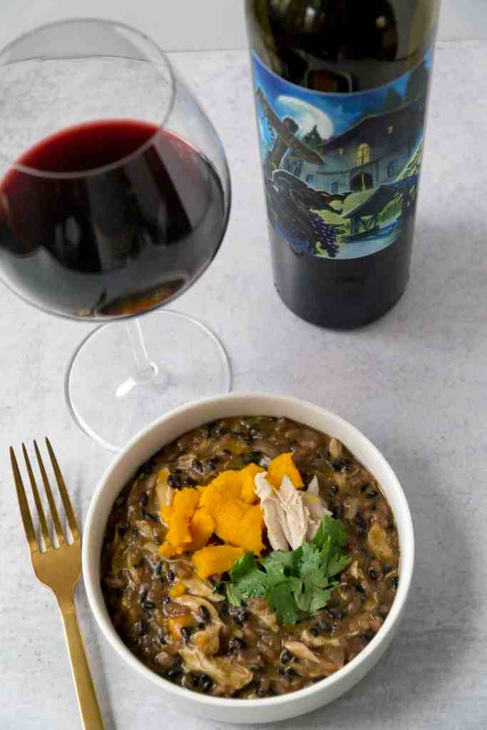 pumpkin black rice risotto with flora spring red wine and golden fork