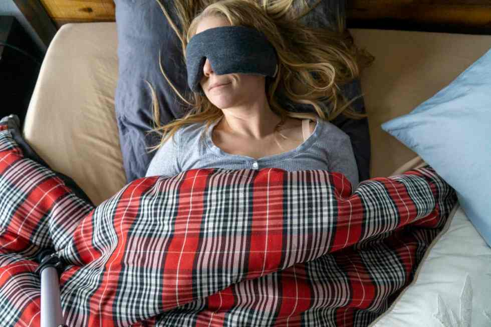 sleep masks in bed with flannel comforter