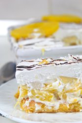 Close up image of banana split lasagna with pineapple, in a white serving plate