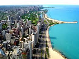 Aerial skyline view of downtown Chicago, Illinois, Lake Shore Drive, and Lake Michigan on a bright sunny day.