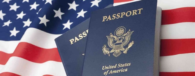 U.S. flag background with 2 U.S. Passports in the foreground