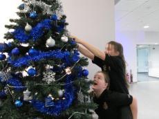 Girls decorating the Christmas Tree (Copy)