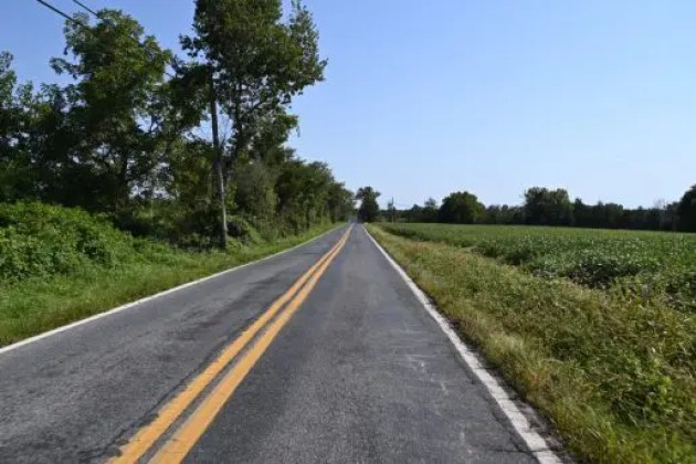 The asphalt roads after the Montgomery Agricultural Preserve are infrequently travelled by motorized vehicles. They are open and wide, and provide plenty of space for all travellers to enjoy the scenery and tranquility of the area. Picture credit: Wandel Guides, 2020.