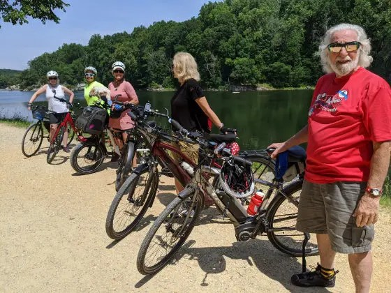 A group of e-bikers standing for a group photo on the C&O Canal Towpath
