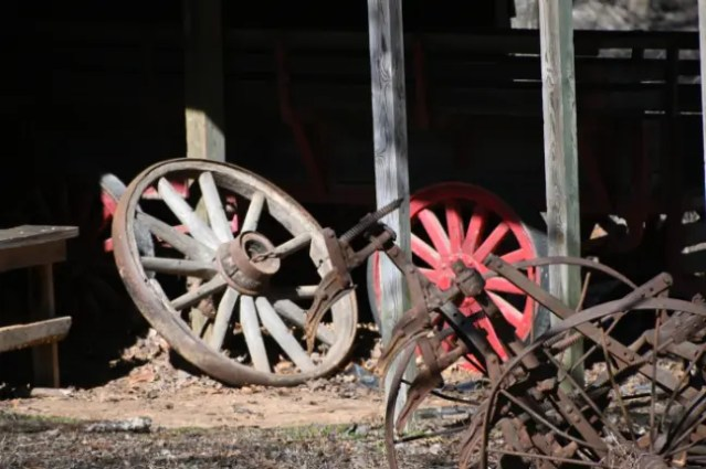 Old wagon wheels on display at the pioneer homestead e-bike lovers