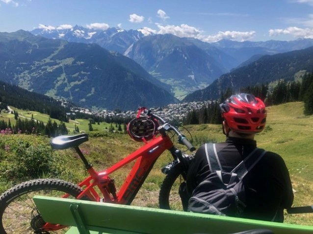 An e-biker taking in the view of the mountains on an alpine ride at an e-bike festival in Verbier, Switzerland.