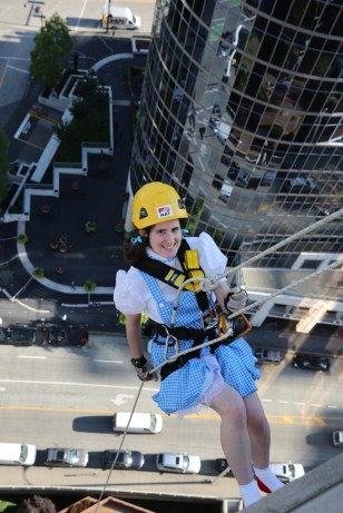 Dressed as Dorothy rapelling down a building for Easter Seals in 2013.