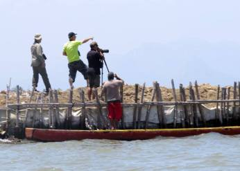 Massive fish ponds built along the Bataan coast line claiming parts of Manila Bay
