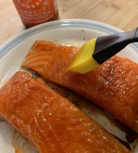 Brush extra sriracha on the salmon