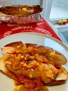 Italian sausage with garden veggies on a pretzel roll!