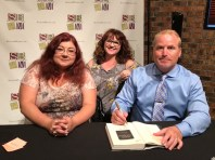 Ilona Andrews book signing with me smiling like an idiot