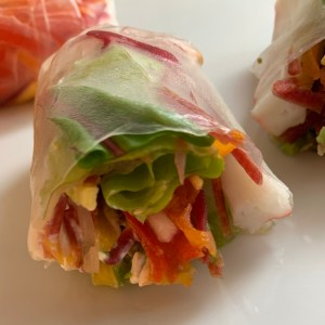 Spring Rolls with carrots, radish, lettuce, crab and radishes