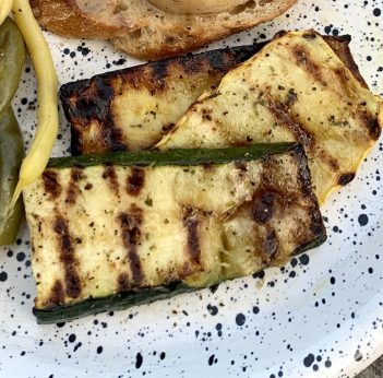 Grilled garden fresh zucchini with olive oil and herbs