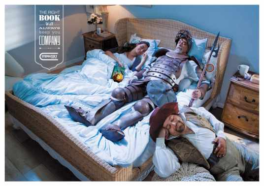 A sleeping reader with Don Quixote and his sidekick in her bed, accompanied by the caption