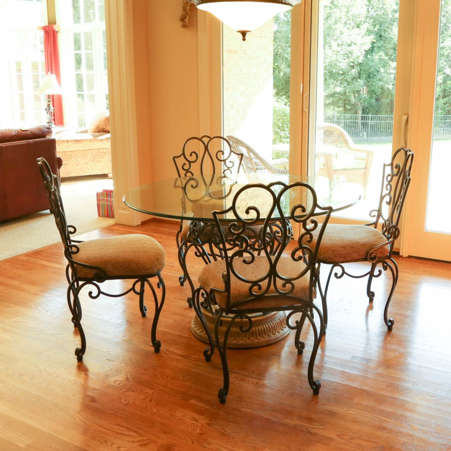 wrought iron glass top table with five chairs by the bombay company