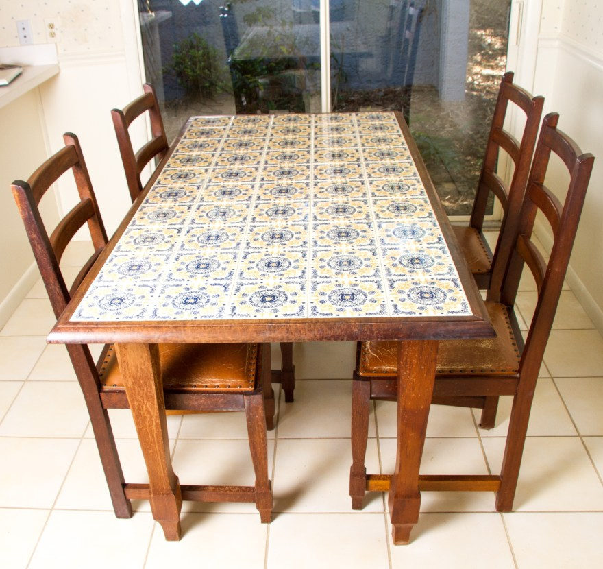 spanish tile top dining table with chairs