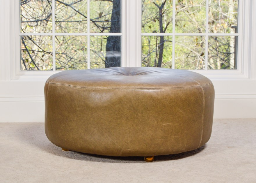 rolling round leather ottoman
