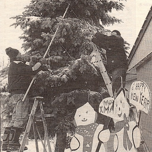 Lawrence Ewasiuk (left) and Archie Hlushak working on a Christmas display for an elderly relative. Image courtesy of Candy Cane Lane organizers.