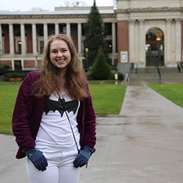Zoe Alley, OSU Summer Session scholarship winner, stands in front of the Memorial Union with her thumbs hooked into the pockets of her pants.