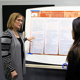 Arien Muzacz, Ph.D. in Counseling alumna and coordinator of the clinical mental health option, presents her research during the program's 100-year celebration event.
