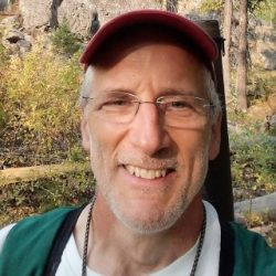 David Stemper takes a selfie in the woods while hiking.